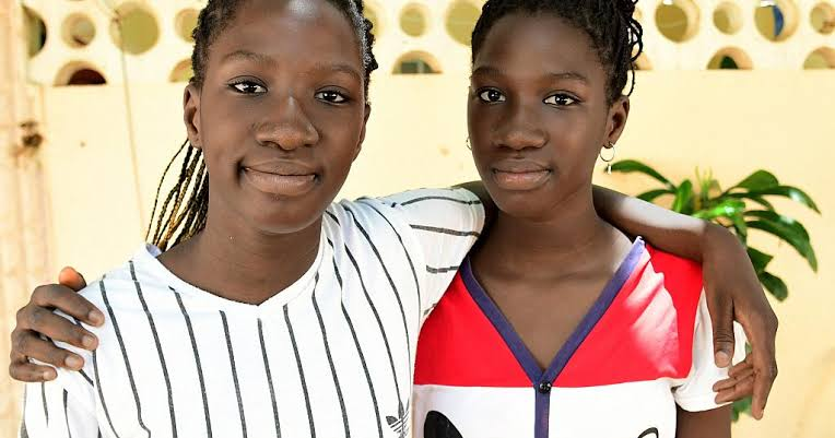 13 year old Senegalese twin girls graduate high school with very  impressive scores